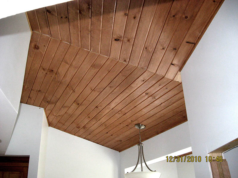 Wood planks over popcorn ceiling Faux wood ceiling planks